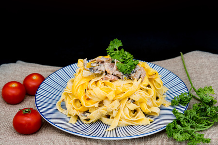 Pasta with pesto sauce and Mushrooms on a the table Stock Photo