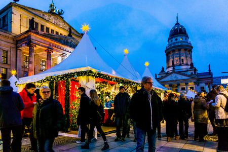 christmastime: BERLIN, GERMANY - DECEMBER 23, 2016: Beautiful decorated booths and christmas lights at Gendarmenmarkt Christmas Market. Editorial