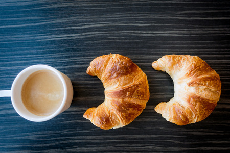 Breakfast with coffee and croissants on table Stock Photo
