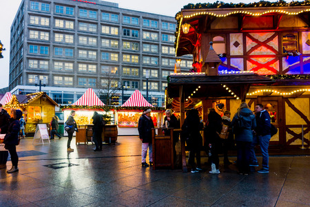 BERLIN, GERMANY - DECEMBER 23, 2016: Beautiful decorated booths and christmas lights at Gendarmenmarkt Christmas Market. Editorial
