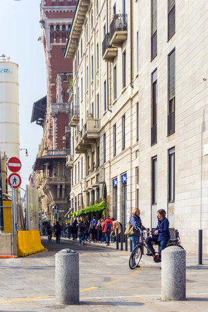 milánó: MILAN, ITALY - March 16, 2017: street view of downtown milan, capital of the Lombardy region, ranking 4th in the European Union Sajtókép