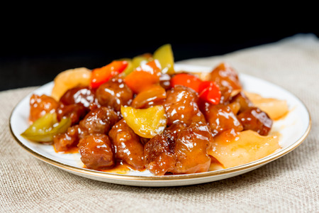 wok fried pork stir fry with sweet peppers and chinese vegetables Banco de Imagens