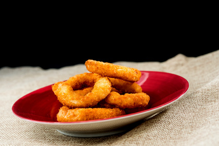 Fast food Homemade Crunchy Fried onion rings Stock Photo