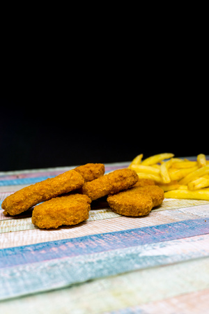Chicken nuggets with golden French fries