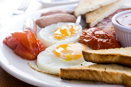 Egg and Toast - classical english breakfast with egg and ham Stock Photo