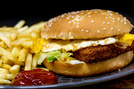 grill: Fish burger with Golden French fries Stock Photo