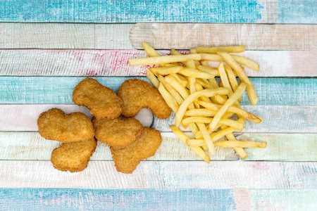 Chicken nuggets with sauce and golden French fries potatoes  Stock Photo