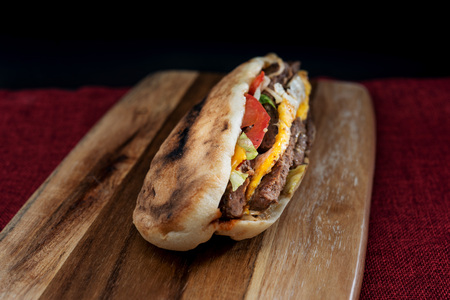 Sandwich with steak, cheese and golden French fries potatoes Stock Photo