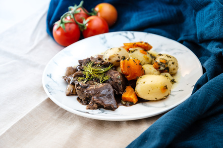 Beef stewed and Carrots potatoes with a wine sauce and herbs Stock Photo