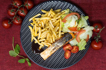 Grilled Salmon with fresh lettuce and Golden French fries
