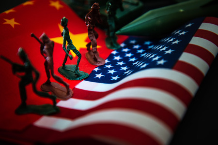 China-US trade war concept - Military Battle on China and American Flags