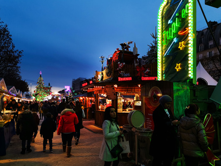 PARIS, FRANCE - DECEMBER 5, 2018: Tourists at the Christmas Market in the Tuileries Garden in Paris