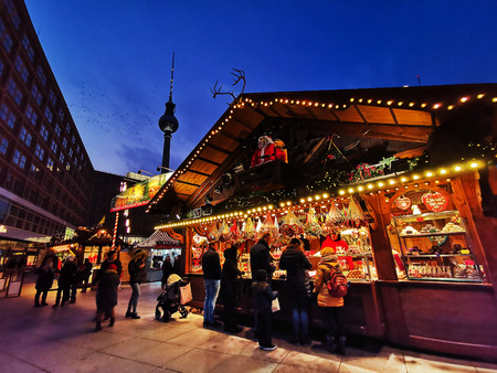 BERLIN, GERMANY-DECEMBER 16, 2018: Beautiful decorated booths and christmas lights at Alexanderplatz Christmas Market.