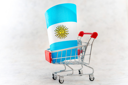 Business concept photo - shopping cart with Argentina flag