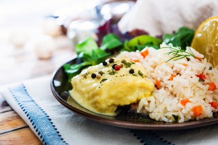 Andalusian fish, saffron rice with vegetables