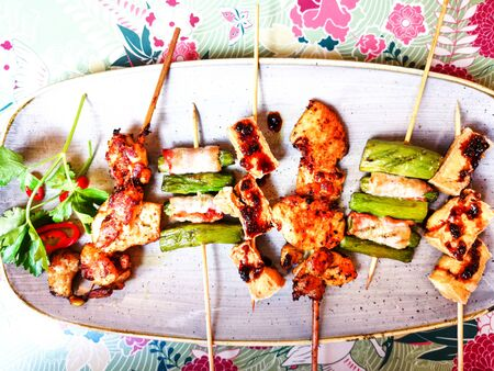 Six asian mixed satay made with tofu, curry chicken, asparagus and bacon Stock Photo