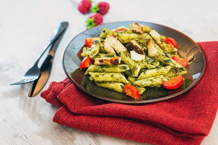 Penne cooked cereal specialty with cooked chicken fillets and a sauce made with olive oil Archivio Fotografico