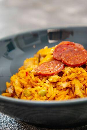 Paella with chicken, seafood and chorizo Stock Photo
