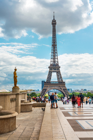 PARIS, FRANCE - July 31, 2019: PARIS, FRANCE - July 31, 2019: The Eiffel Tower is a wrought-iron lattice tower on the Champ de Mars in Paris, France. Stock Photo - 130138181