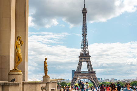 PARIS, FRANCE - July 31, 2019: PARIS, FRANCE - July 31, 2019: The Eiffel Tower is a wrought-iron lattice tower on the Champ de Mars in Paris, France. Stock Photo - 130138182