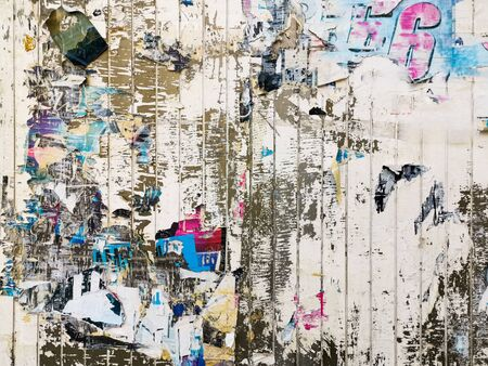 Layers of old colorful posters on wall damaged by time for your grunge style design Reklamní fotografie