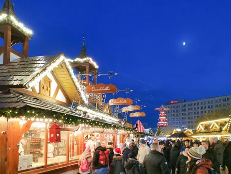 BERLIN, GERMANY-DECEMBER 16, 2018: Beautiful decorated booths and christmas lights at Alexanderplatz Christmas Market. Stock Photo