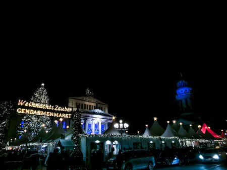 BERLIN, GERMANY-DECEMBER 16, 2018: Beautiful decorated booths and christmas lights at Gendarmenmarkt Christmas Market. Stock Photo