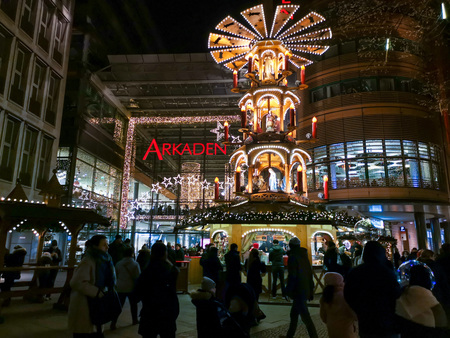 BERLIN, GERMANY-DECEMBER 16, 2018: Tourists at the Christmas Market in Berlin