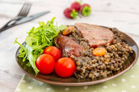 Green lentils with smoked pork sausage smoked choice, carrots and onions