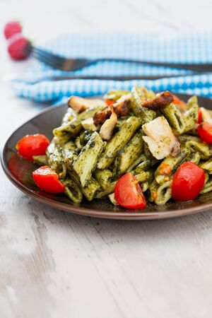 Penne cooked cereal specialty with cooked chicken fillets and a sauce made with olive oil