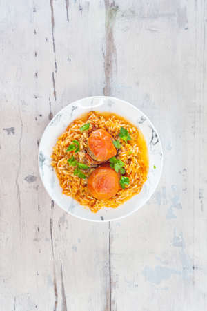 Stuffed tomatoes and rice with tomato Imagens