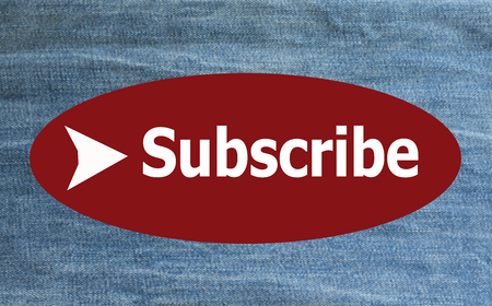 Subscribe on blurred jeans background