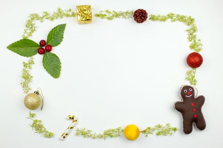 gingerbread man: frame with Christmas decorations on white background. flat lay. Christmas concept. Stock Photo
