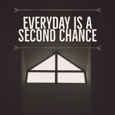 Inspirational motivational quote Everyday is a second chance on window black and white background.
