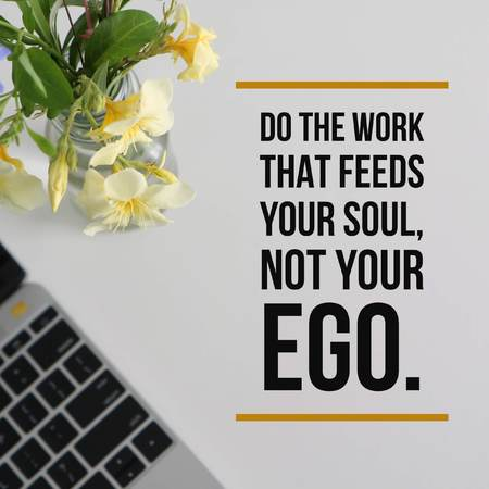 Inspirational motivational quote Do the work that feeds your soul, not your ego on laptop with flowers vase background. Фото со стока