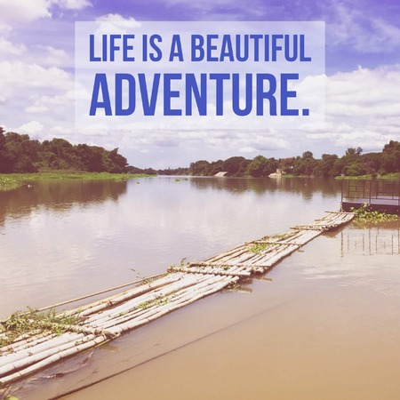 Inspirational motivational quote life is a beautiful adventure. with river nature background.
