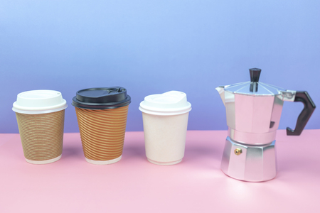 Mock up of coffee paper cups with coffee maker on colorful background.