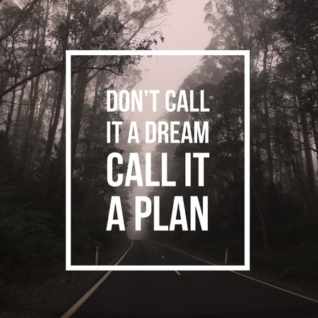 Inspirational motivational quote Dont call it a dream, Call it a plan. on forest and road background. Фото со стока