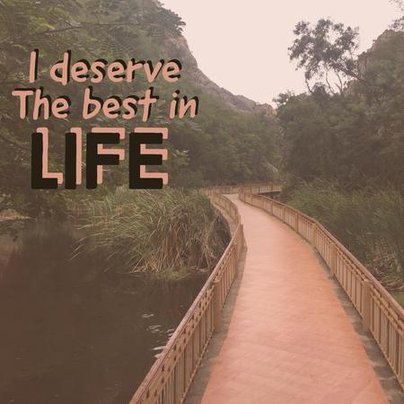 Inspirational motivational quote I deserve the best in life. with walking trace and mountain background. Фото со стока