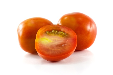 Ripe tomatoes isolated on white photo