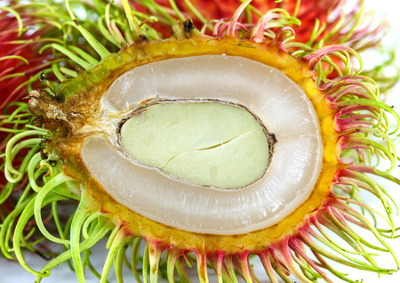 Rambutan fruit with red shell on white background