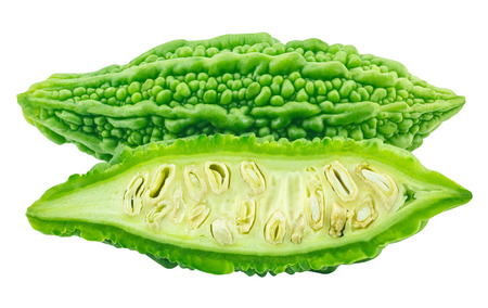 slices of bitter gourd arranged on white background