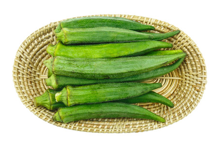 Lady Fingers or Okra isolated in basket on white