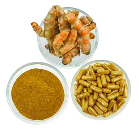 Turmeric (Curcuma longa L.) root and turmeric powder for alternative medicine ,spa products and food ingredient. Stock Photo