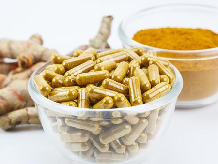 gastro: Turmeric (Curcuma longa L.) root and turmeric powder for alternative medicine ,spa products and food ingredient. Stock Photo