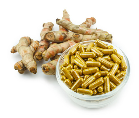 gastro: Turmeric (Curcuma longa L.) root and turmeric capsule powder for alternative medicine ,spa products and food ingredient.