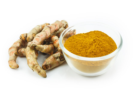 gastro: Turmeric (Curcuma longa L.) root and turmeric powder for alternative medicine ,spa products and food ingredient. Stock Photo