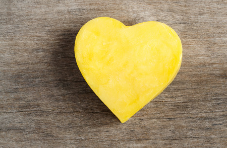 yellow heart shape on wood background