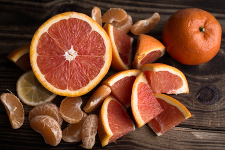 the orange mandarin red on wood Stock Photo