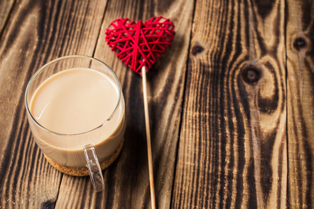 a cup of coffee with milk and handmade heart Stock Photo
